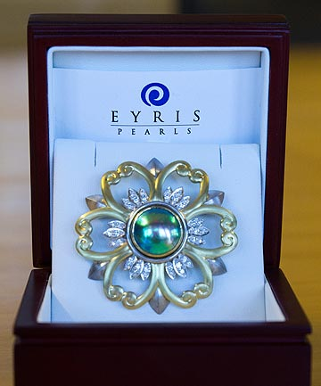 GIFTS: Key gave the Queen a blue pearl brooch from a Christchurch company as well as a case of premium New Zealand wines.