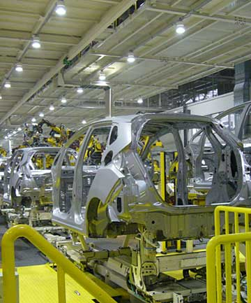 There's not a worker in sight as Honda Jazz hatchbacks (called Fit in Japan) move along the assembly