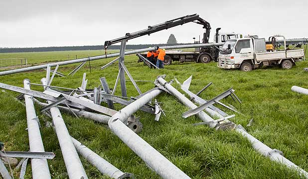With twisted irrigator parts laying on the ground, a repair crew works on a damaged centre pivot near Methven.