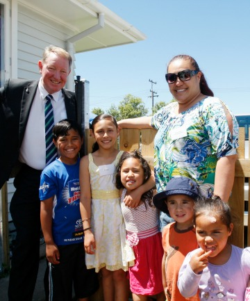 Nick Smith, with the family whose Housing NZ house had just been made safer as part of the Driveway Safety Programme