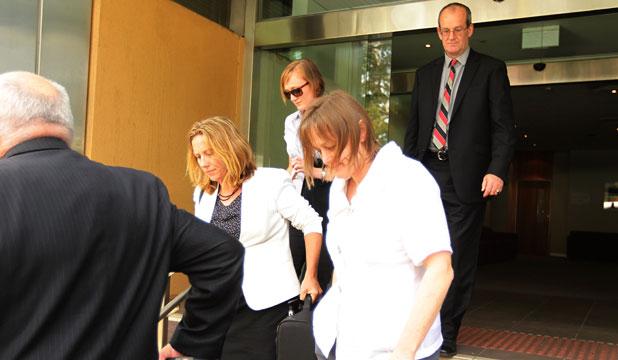 The family of Alec Meikle, sister Rebecca, third from left, mother Andrea, second from right, and father Richard Meikle, right, leave court.