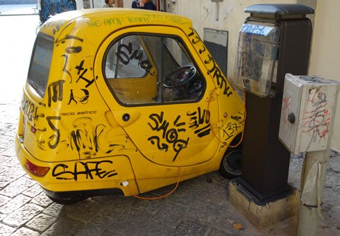 Tatty electric car in Italy.