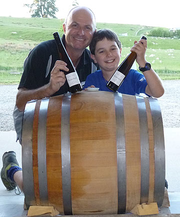 Daniel and Thomas Schwarzenbach with the barrel and the wine that came out of it.