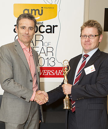 Fairfax Media NZ chief executive Simon Tong presents Volkswagen NZ managing director Tom Ruddenklau with the NZ Autocar Car of the Year award for the Volkswagen Golf.