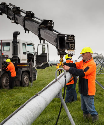 Repair crews work on a twisted centre pivot at a Methven farm.