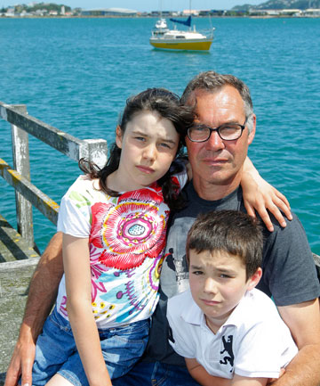 Dean Fraser at Evans Bay Marina with his children Kate, 9, and Thom, 7