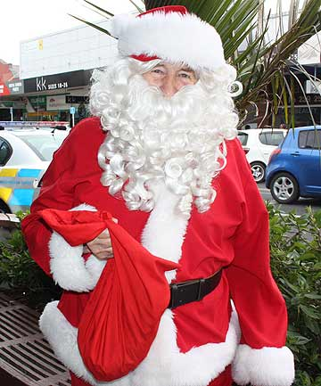 CHRISTMAS SPIRIT: Santa Claus was back on the streets of Pukekohe just one day after his wallet was stolen by three children.