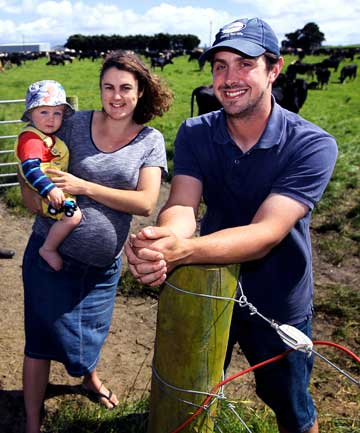 Farmers/sharemilkers Jody and Charlie McCaig with their son Finley, 18 months.