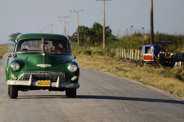 Fidel Roque drives the US-made 1952 Chevrolet car he affectionately named Miss Green, towards home from the village of Isabela de Sagua, 240 km east of Havana.