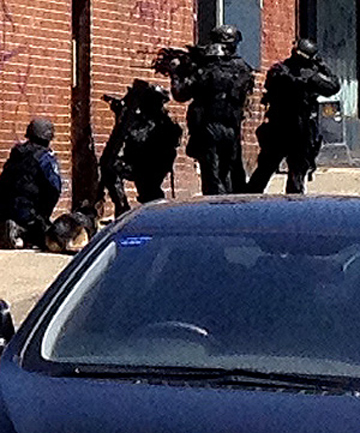 Armed police sealed off a block on Sydney's Parramatta Road