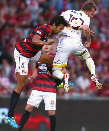 Nikolai Topor-Stanley of the Wanderers competes with Jeremy Brockie of the Phoenix.