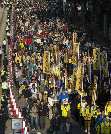 Thousands of pro-democracy protesters march in the street in Hong Kong