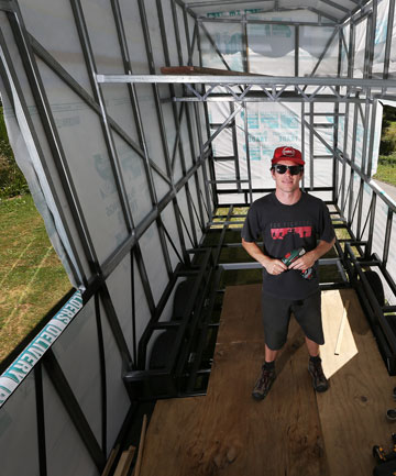 Student building tiny mobile home