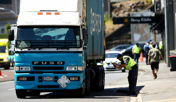 Police at the scene of a fatal truck and cycle accident in central Auckland.