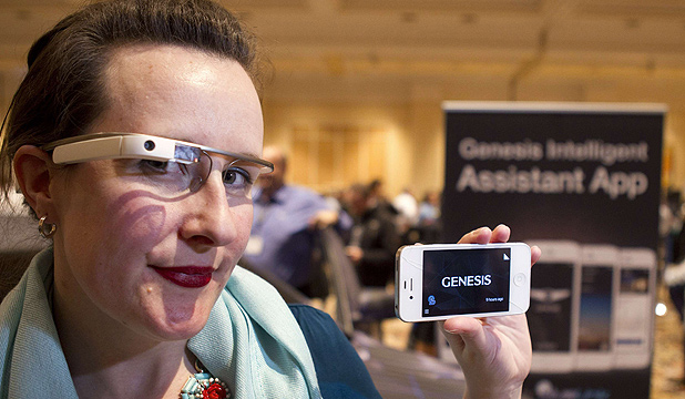 Jen Shepherd Moore wears Google Glass, which is to be integrated with Hyundai's luxury Genesis sedan at the launch at the Consumer Electronics Show in Las Vegas.