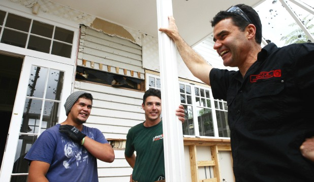 Scotty's Construction owner Scott Feasey, right, finds good-natured teasing with workers James Kopu, left, and Michael Handley