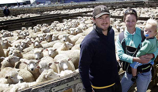 Hamish Hawker and Steph Holloway with one-year-old Ash Hawker at the Feilding ewe fair.