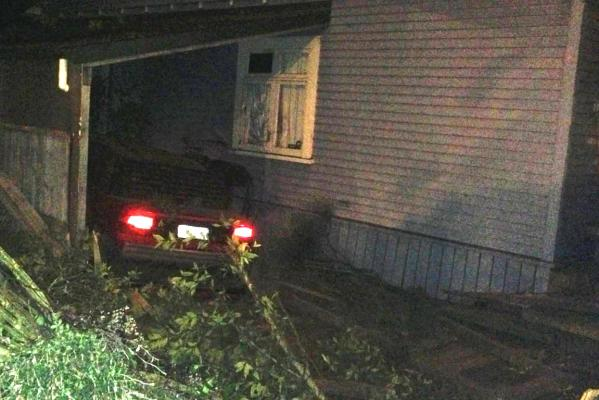 Police say a fleeing driver who had sped off after ramming a patrol car came to a halt after smashing into two properties and landing on top of a parked car.