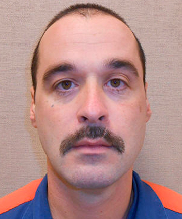ON THE RUN: Convicted killer Michael David Elliot.