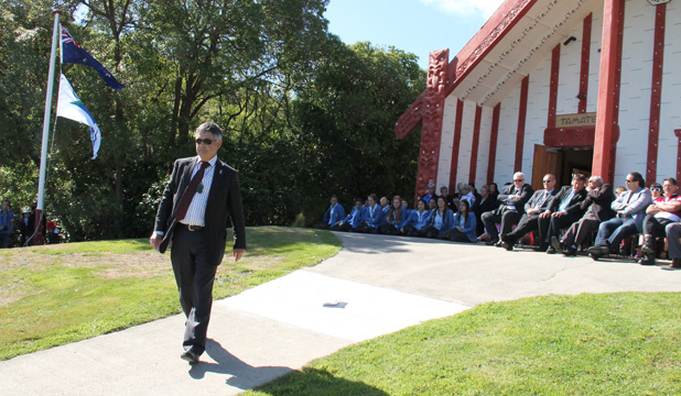 David Cull returns to seat after speech at marae