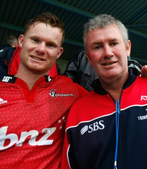 Mitchell Drummond, left, and dad Shane at his Crusaders debut.
