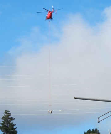 Helicopter hovers over power lines, Wellington