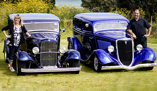 Sister and brother, Anna Etheridge (left) and Lloyd Garrick, with their 1932 and 1934 Ford hot rods.