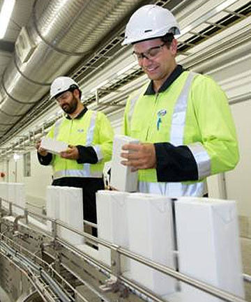 Fonterra employees Te Ngahau Bates (left) and Eddie West monitor an Anchor UHT processing line at the company's new $120m processing site at Waitoa.