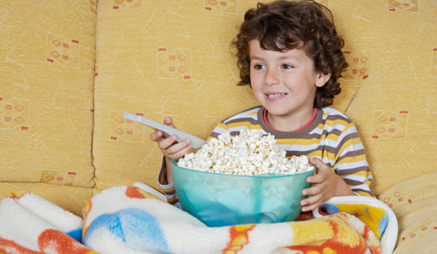 Boys eat more watching TV