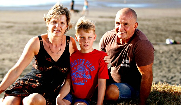 Nicholas, 10, and his mother Jana Dunnet meet up with Nicholas' saviour Mark Brough at Fitzroy Beach last night.
