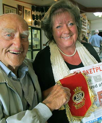 Vivien Foster presents merchant seaman veteran Harry Rowe