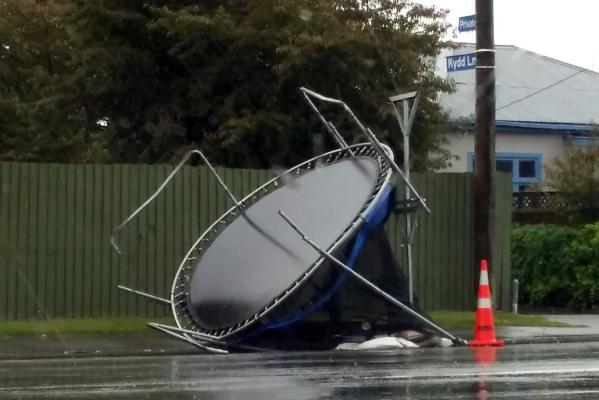 Trampoline flung down Shands Rd
