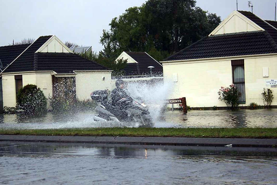 Aldwins Road motorcyle in flood