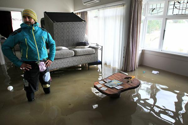 Mike Barber in flooded house