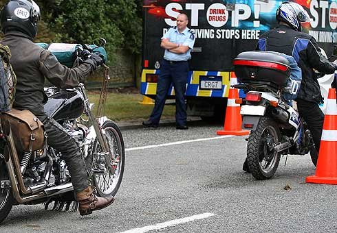 Motorcyclists stopped at a police checkpoint.