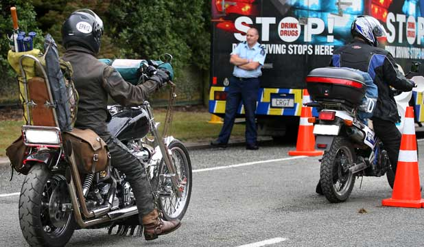 Motorcyclists are stopped at a police checkpoint in Waimate during the 2013 March Hare rally.
