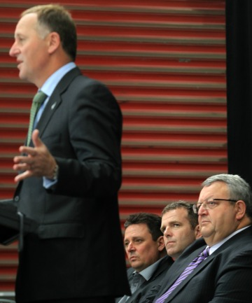 Prime Minister John Key with Spanbild CEO Peter Jensen, rear left, Mike Greer, and Gerry Brownlee.