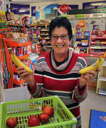 Judith Kitchen holds two of the last bananas available in Timaru
