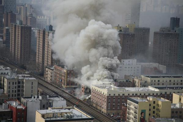 An explosion has levelled two New York apartment buildings in East Harlem.