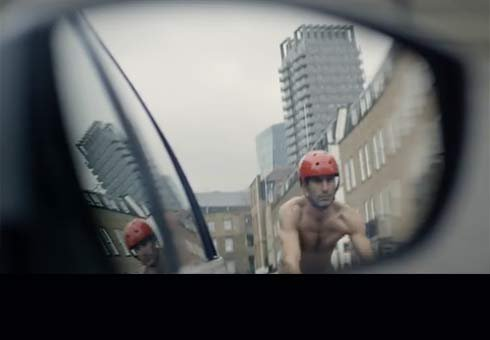 Naked cyclist in rear view mirror.