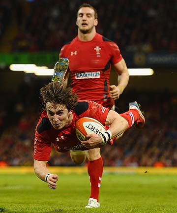 Rhodri Williams of Wales dives in to score a second half try during their 51-3 Six Nations win over Scotland at Millennium Stadium in Cardiff.