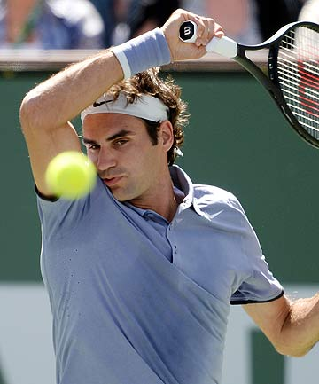 Roger Federer whips a forehand return during his semifinal victory over Alexandr Dolgopolov at the BNP Paribas Open at Indian Wells in the US.