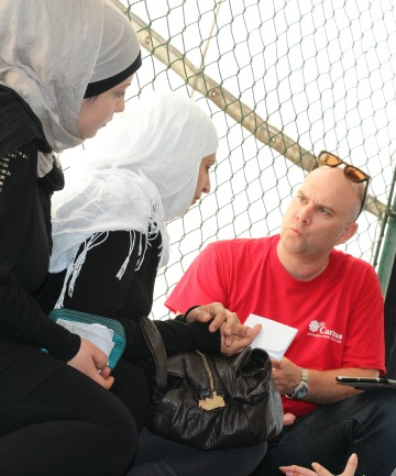Mark Mitchell talks with Syrian refugees in Lebanon.