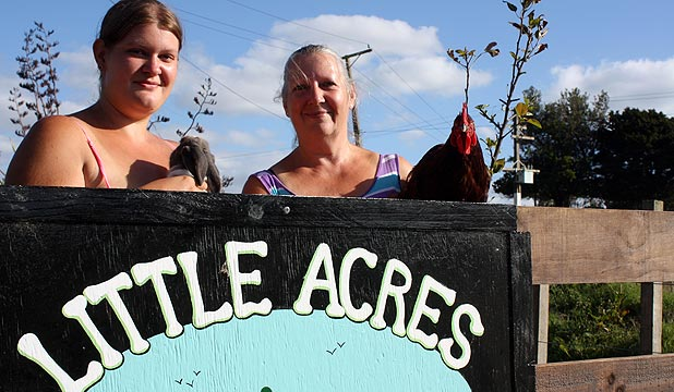 Jacqui Emmett, right, and daughter Charlie run Little Acres, a rescue and rehoming service for farm animals near Te Akau along with husband Barry.