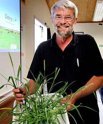 AgResearch scientist Trevor James with a sample of the invasive yellow bristle grass, which is spreading around Taranaki.