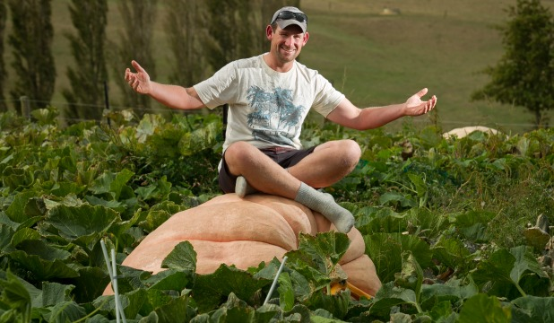 Farmer Tim Harris on his pumpkin which he plans to sail in tomorrow.
