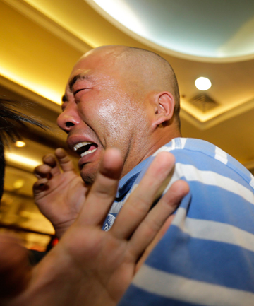 Families react to news MH370 crashed