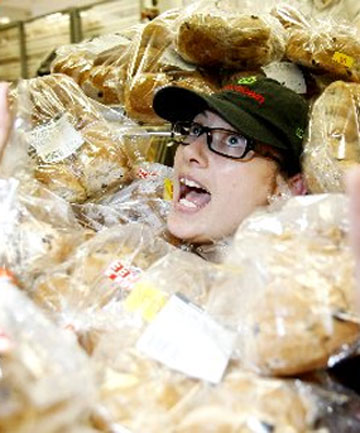Rebecca Stevenson, apprentice baker at Countdown supermarket with a batch of freshly made Hot Cross Buns