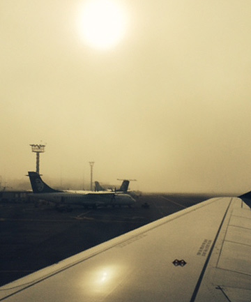 FOGGY: Fog rolls over the apron at Auckland airport.