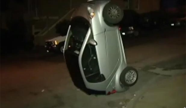 A Smart car is upended in San Francisco.